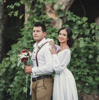 Man in shirt and a girl in a wedding dress