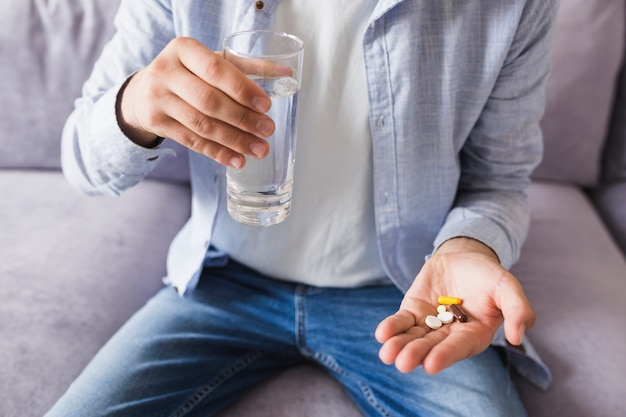 Man in shirt with pills