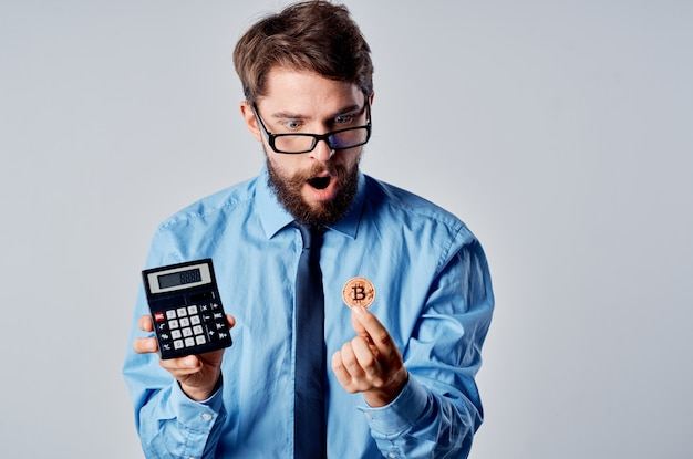 Man in shirt with tie calculator cryptocurrency finance investment
