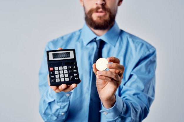 Man in shirt with tie cryptocurrency bitcoin calculator finance manager