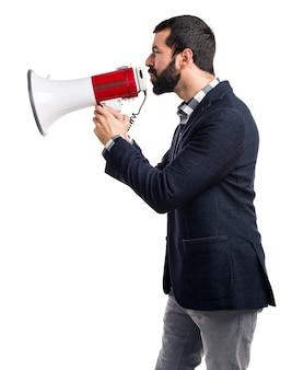 Man shouting by megaphone