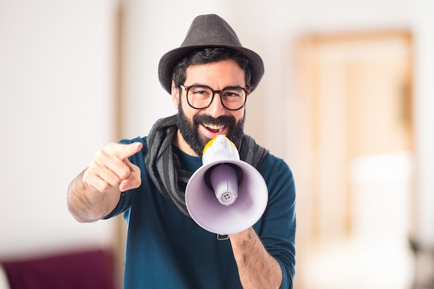Man shouting by megaphone Free Photo