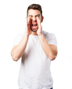 Man shouting with hands on face