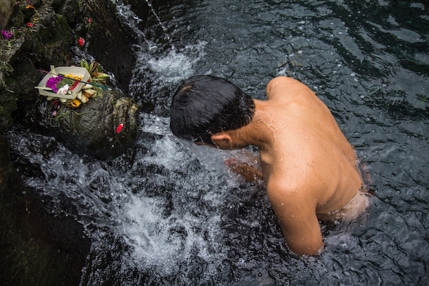A man shower  holy water in baly