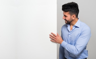 Man showing a blank board