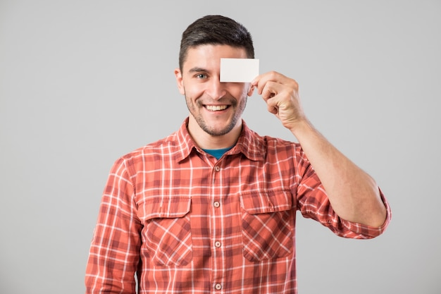 Man showing blank business card