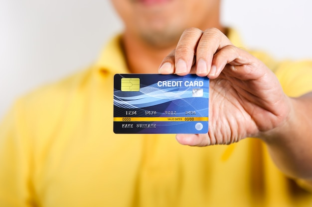 A man showing credit card on white