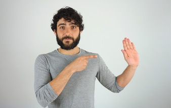 Man showing direction and pointing with finger