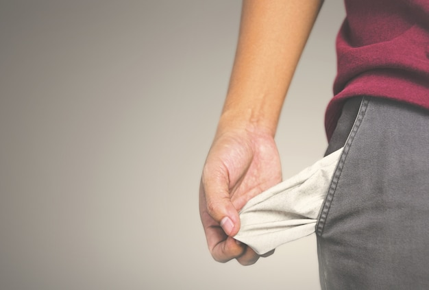 Man showing has no money by turning out the pocket
