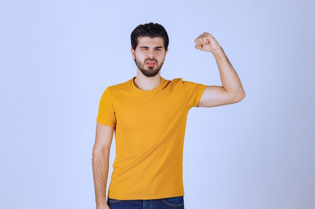 Man showing his arm muscles and feels powerful.