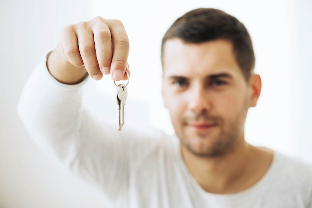 Man showing keys from new