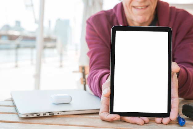 Man showing new digital tablet with blank white screen