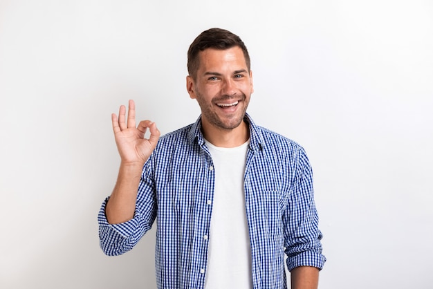 Man showing ok gesture in studio