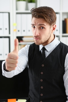 Man showing ok sign at office