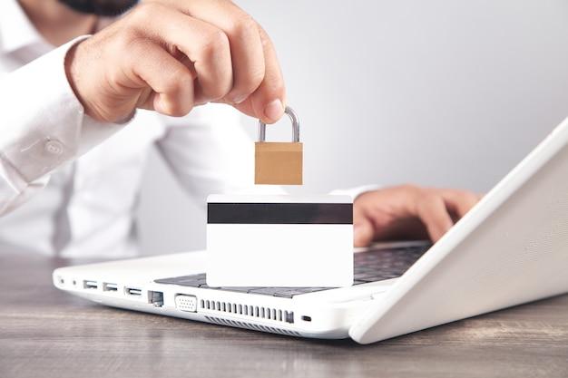 Man showing padlock. credit card, internet, computer security