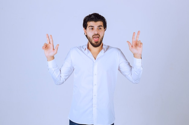 Man showing peace and friendship sign.