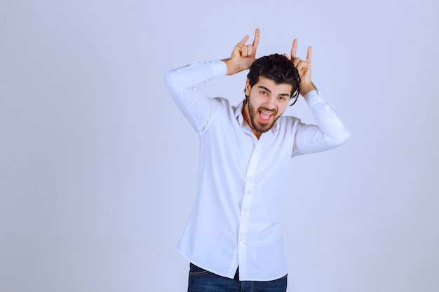 Man showing rabbit or wolf hand sign.