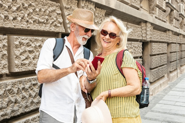 Man showing something on the woman's phone while smiling