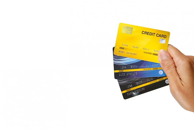 A man showing three credit cards isolate on white background.