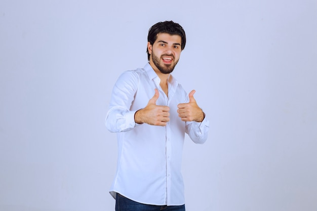 Man showing thumb up hand sign.