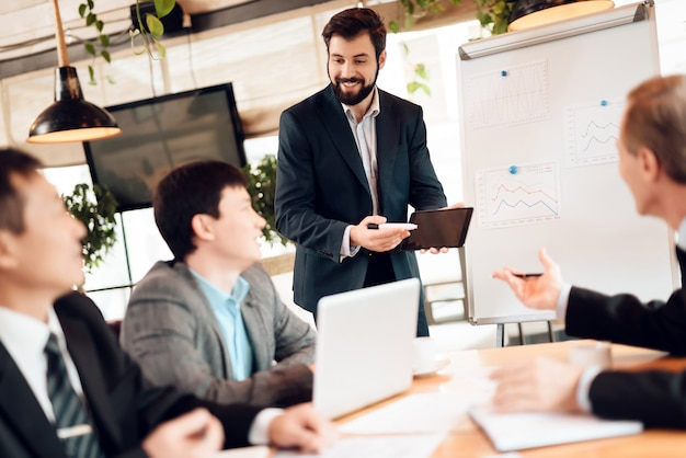 Man shows colleagues how to improve work