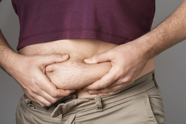 The man shows problems with overweight in the abdomen