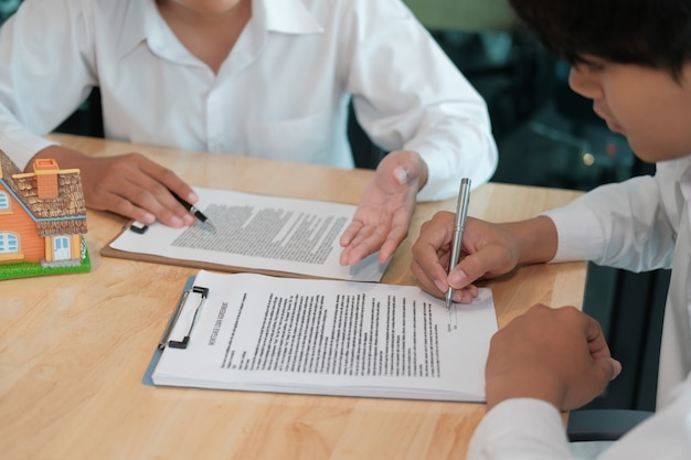 Man sign contract agreement with realtor. buying, selling renting real estate property