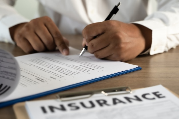 Man signing insurance policy