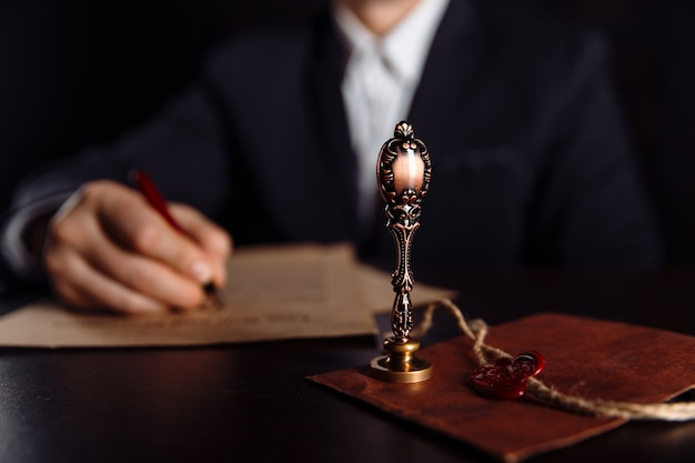 Man signing a last will and testament document in notary public office