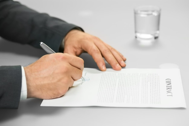 Man signs document. chief's decision. boss signs contract. the meeting went well.