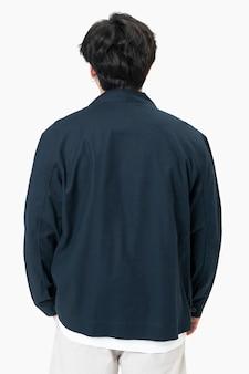 Man in simple navy jacket portrait street fashion rear view