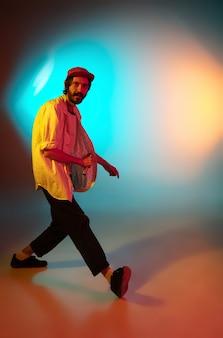 Man singer performing on neon light