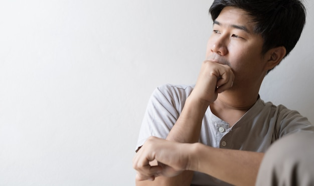 Man sitting alone feeling sad and worried