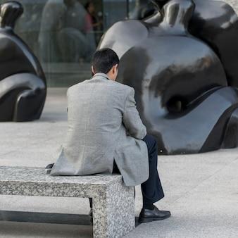 Man sitting on bench, santiago, santiago metropolitan region, chile