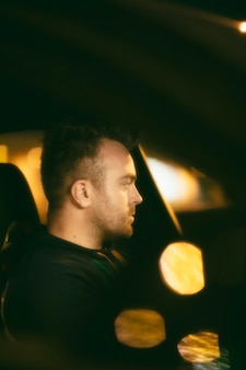 Man sitting in the car at night