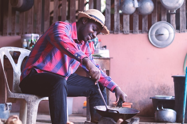 Man sitting and cooking in the kitchen