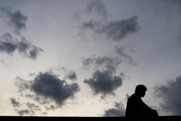 Man sitting on deck, silhouette, shadow