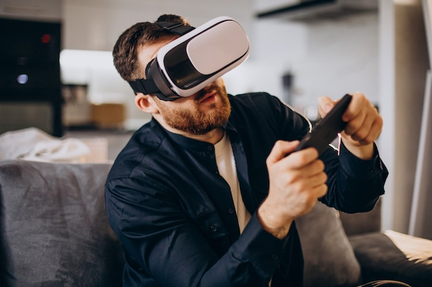 Man sitting at home and using vr
