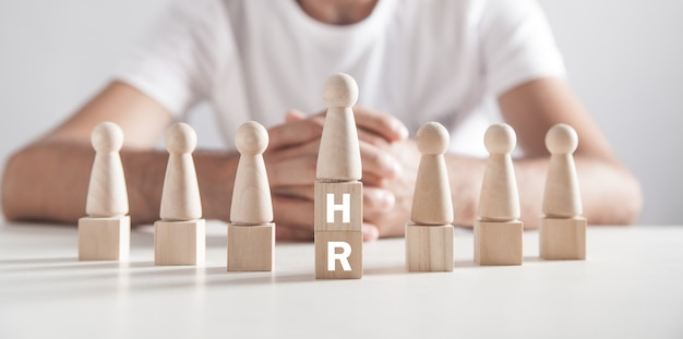 Man sitting in office. hr word on wooden cubes. human resources