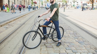 Man sitting on bicycle in city