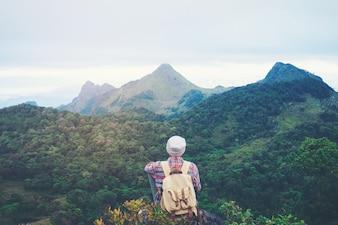 Man sitting on mountain,adventure travel concept
