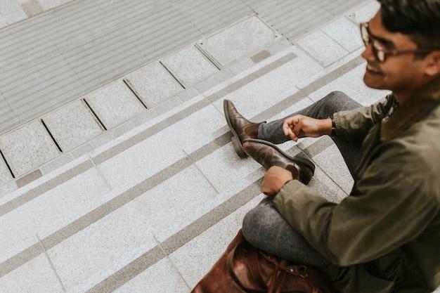 Man sitting on stair steps