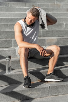 Man sitting on stairs after training