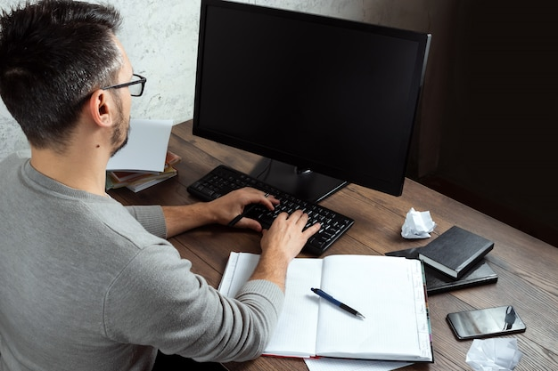 Man sitting at a table in the office