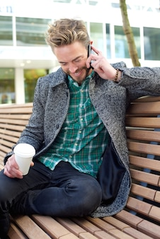 Man sitting and talking on mobile phone