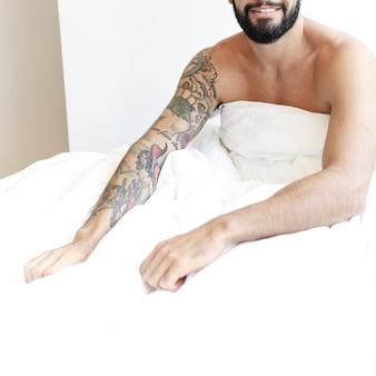 Man sitting with white blanket