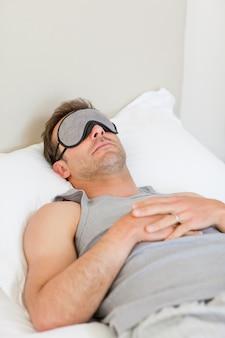 Man sleeping on his bed