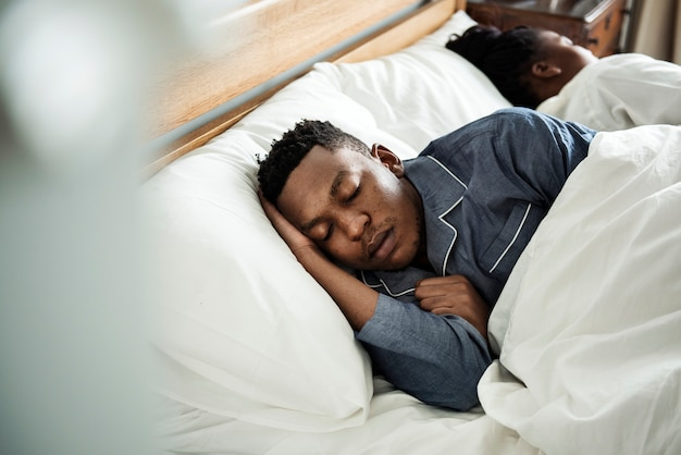 A man sleeping soundly in bed