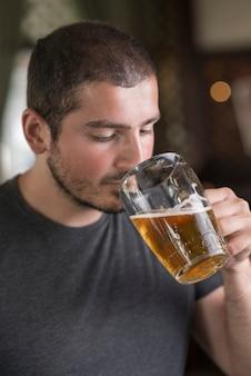 Man smelling beer in bar
