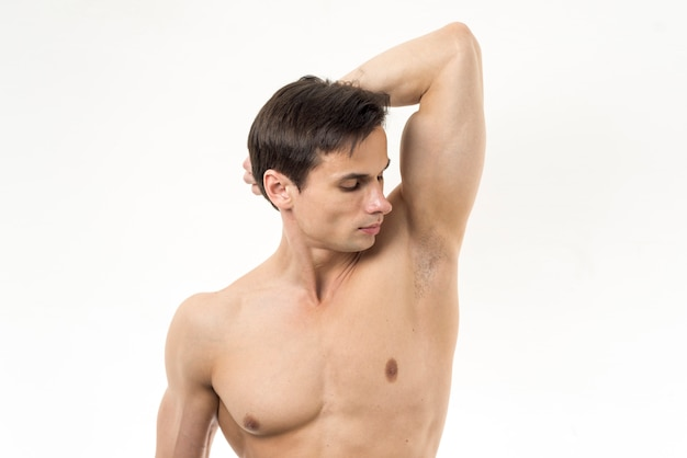 Man smelling his armpit with white background